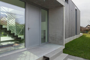 Entrance of a modern house in concrete and wood, outside